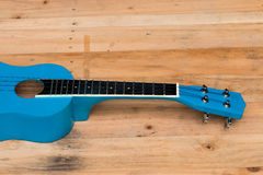 Close up ukuleles on wooden background Stock Images