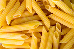 Close up of uncooked dry pene pasta Royalty Free Stock Images