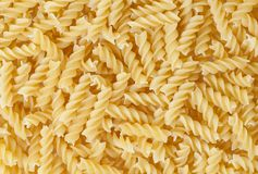 Uncooked fusilli pasta background Royalty Free Stock Photography