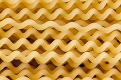Close up of uncooked spiral fusili Italian pasta. Close up macro of uncooked spiral fusili Italian pasta in a full frame background texture for use as an royalty free stock photos