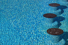 Close up of underwater seats in a luxury resort pool Stock Image