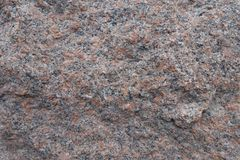 Closeup of uneven surface of pink granite stone royalty free stock photo