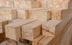 Close-up of unevenly  protruding sawn rectangular wooden pine bl Royalty Free Stock Photo
