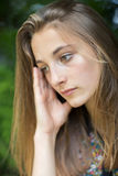 Close Up Of Unhappy Teenage Girl Sitting Outdoors royalty free stock photo