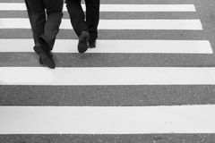 Close-up on unidentified people legs crossing street. Close-up onbusinessman legs crossing street Stock Photo
