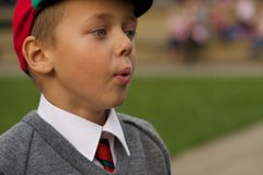 Close-up of uniformed schoolboy blowing out cheeks Stock Photos