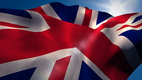 Union flag waving against sky on a sunny day. Close-up of union flag waving against sky on a sunny day stock video footage