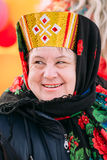Close up of unknown beautiful aged woman in national folk clothes Royalty Free Stock Images