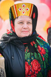 Close up of unknown beautiful aged woman in national folk clothes at Celebration of Maslenitsa Shrovetide holiday Stock Photos