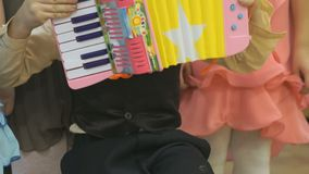 Boy playing on toy accordion stock footage