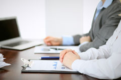 Close up  of unknown  business people at meeting discussing financial results Royalty Free Stock Photo