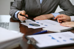 Close up  of unknown  business people at meeting discussing financial results Stock Images