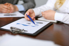 Close up  of unknown  business people at meeting discussing financial results Royalty Free Stock Photography