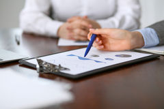 Close up  of unknown  business people at meeting discussing financial results Stock Photo