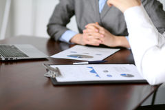 Close up  of unknown  business people at meeting discussing financial results Stock Photos