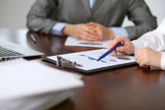 Close up  of unknown  business people at meeting discussing financial results Royalty Free Stock Images
