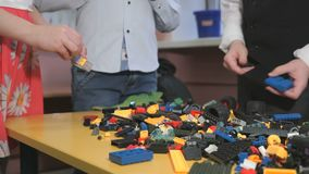 Children playing with building kit. Close-up stock footage