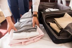 Businessman Packing Bags for Travel stock photo
