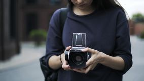 Close up of an unrecognizable girl with an old fashioned camera outside stock footage