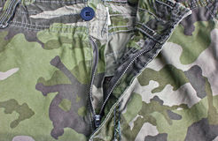 Close Up of Unzip Military Trousers. Close Up of Unzip Military Trousers-The Camouflage Fabric Royalty Free Stock Photos