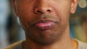 Close up of Upset Sad Afro-American Man Face, Lips Reaction. 4k , high quality stock footage