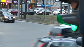 Close up urban city traffic light changing to green from red signal cars to proceed across intersection. Traffic lights in a street scene. Close up urban city stock video footage