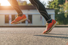 close up of urban runner's legs run on the street with copy space Royalty Free Stock Image