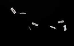 Close up of us dollar money flying over black Royalty Free Stock Photos