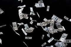 Close up of us dollar money flying over black Stock Images