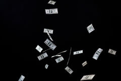 Close up of us dollar money flying over black Royalty Free Stock Images