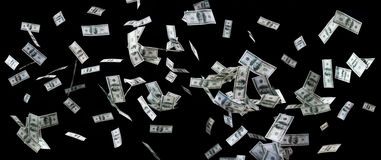 Close up of us dollar money flying over black Stock Photography