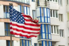 Close up of the us flag against city skyline.  Royalty Free Stock Photography