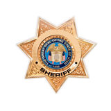 Close up of a US sheriff golden star Royalty Free Stock Photography