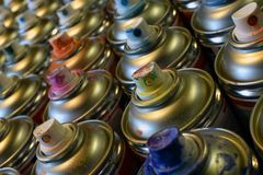 Aerosol paint cans. Close up of used aerosol paint cans in rows stock photos