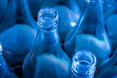 Used bottles waiting for reuse. Close up used blue empty glass bottles waiting for reuse Stock Photos