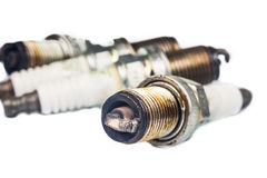Close up of used spark plugs with focus on the electrode with deposits Stock Photos