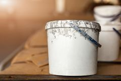 Close-up used white dirty plastic paint bucket in room. Renovation and repair process concept. Copyspace, product. Placement. Place fot rext royalty free stock photo