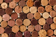 Close-up of used wine corks forming a pattern creating an original background. Close-up of used wine cork stoppers forming a pattern creating an original stock image