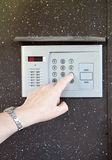 Close-up of uses intercom. In steel door royalty free stock image
