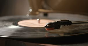 Close up of vinyl record on DJ turntable record player. Close-up of using an antiquarian vinyl record player stock footage