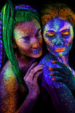 Close up uv portrait of 2 woman Stock Image