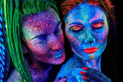 Close up uv portrait of 2 woman Stock Photography