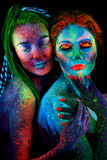 Close up uv portrait of 2 woman Royalty Free Stock Image