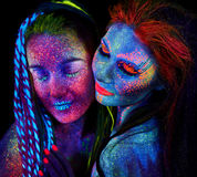 Close up uv portrait of 2 woman Royalty Free Stock Photos