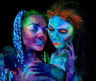 Close up uv portrait of 2 woman Stock Images