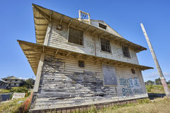 Close-up of vacant decayed house with blown out windows. Deserted and neglected housing in Monterey County, California; tagged with graffiti and forgotten royalty free stock photography