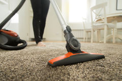 Close up of the vacuum cleaner brush on the carpet Stock Photos