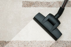 Close up of vacuum cleaner nozzle cleaning carpet at home Stock Photos
