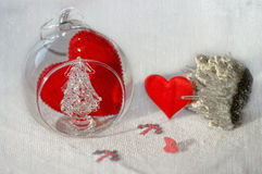 Close-up for Valentines Day. A beautiful still-life special for Valentines day with some hearts,a glass ball and a crystal Stock Photography