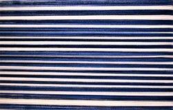Close-up van Blauwe en witte gestreepte afwijking Handweaving textiel vezel royalty-vrije stock foto